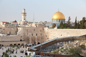 "View of the famed ""Western Wall"" of the Temple Mount. The golden Dome of the Rock dominates the view of Modern Jerusalem."